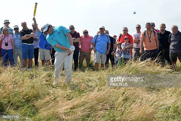 South Africa's George Coetzee plays out of the rough on the 17th hole during his second round 69 on day two of the 2014 British Open Golf...