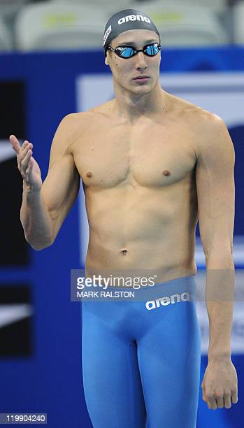 South Africa's Gideon Louw gestures prior to compete in the heats of the men's 100metre freestyle swimming event in the FINA World Championships at...