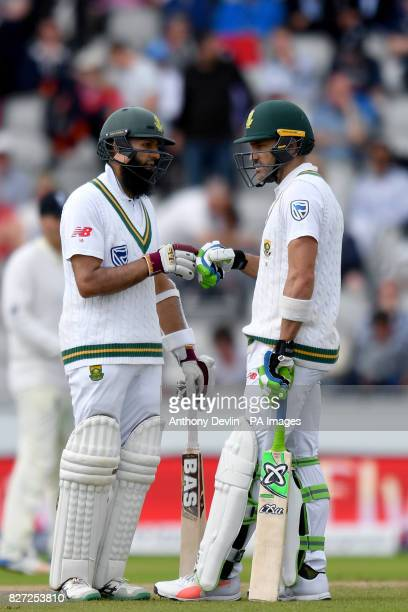 South Africa's Hashim Amla and captain Faf du Plessis touch gloves as Amla reaches 50 not out during day four of the Fourth Investec Test at Emirates...