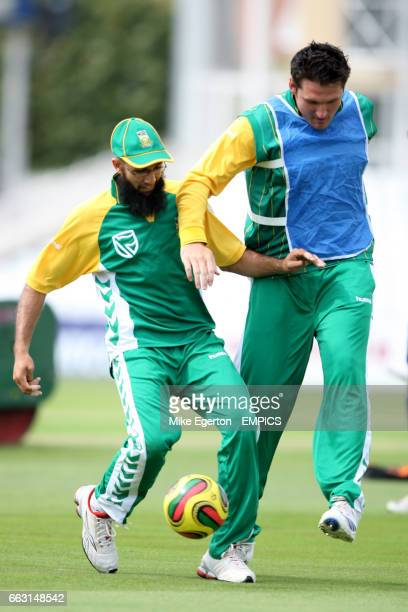 South Africa's Hashim Amla and Graeme Smith play football during net practice