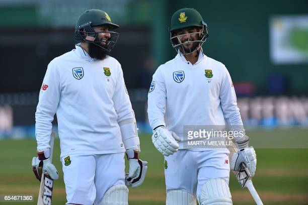 South Africa's Hashim Amla and teammate JeanPaul Duminy walk from the field after winning the 2nd test during day three of the second Test cricket...