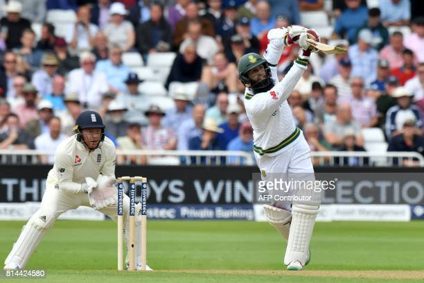 South Africa's Hashim Amla hits a six to reach 50 not out during play on the first day of the second Test Match between England and South Africa at...