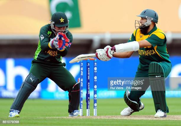 South Africa's Hashim Amla is bowled by Pakistan's Saeed Ajmal caught Mohammad Hafeez for 81 during the ICC Champions Trophy match at Edgbaston...