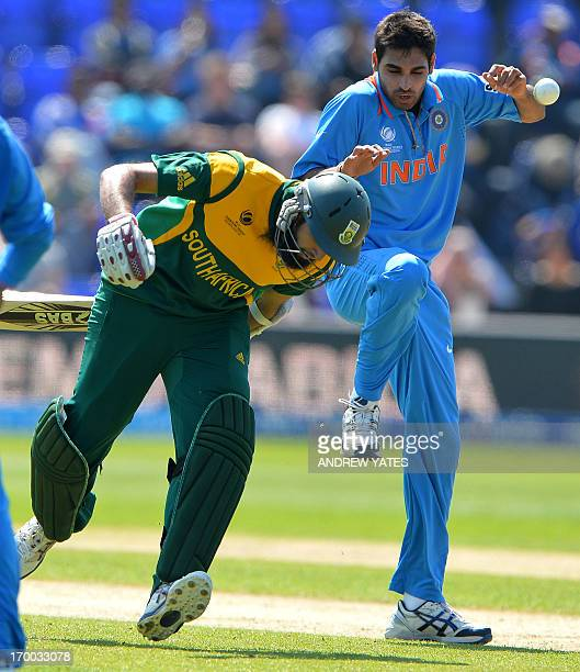 South Africa's Hashim Amla makes his ground by passing India's Bhuvneshwar Kumar during the 2013 ICC Champions Trophy cricket match between India and...