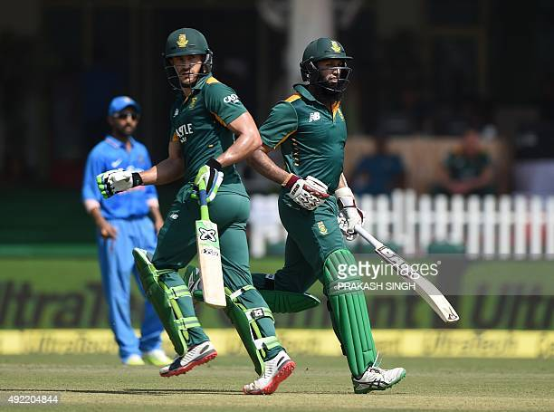 South Africa's Hashim Amla R0 and teammate Faf du Plessis runs between the wickets during the first one day international cricket match between India...