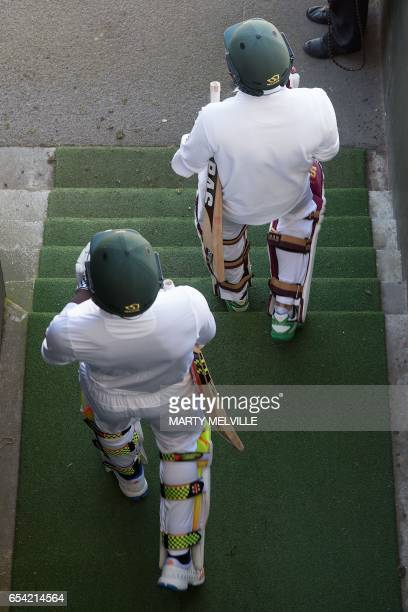 South Africa's Hashim Amla with team mate Kagiso Rabada walk to the field at the start of the days play during day two of the 2nd International...