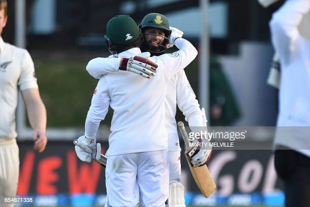 South Africa's Hashim Amla with teammate JeanPaul Duminy celebrate after winning the 2nd test during day three of the second Test cricket match...