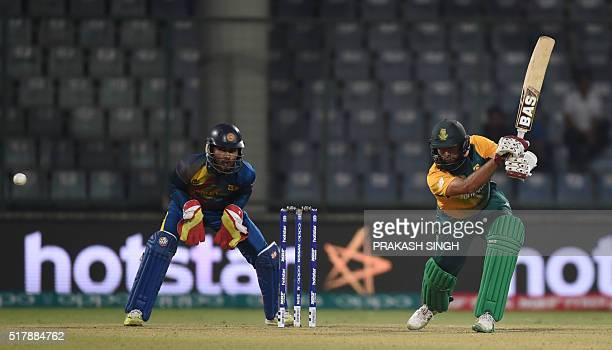 South Africa's Hashim Amlais watched by Sri Lanka's wicketkeeper Dinesh Chandimal as he plays a shot during the World T20 cricket tournament match...