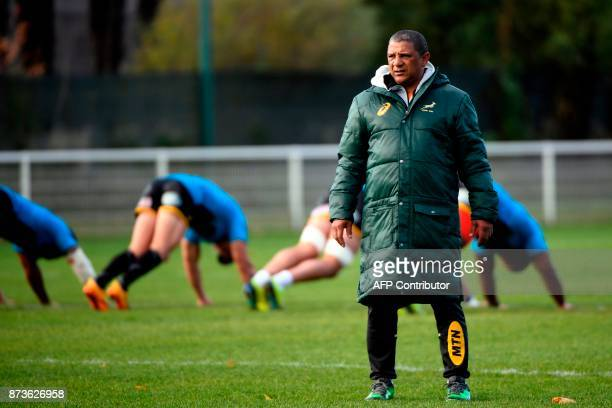 South Africa's head coach Allister Coetzee watches his players during a training session at the Stade du Saut du Loup Stadium in Paris on November 13...