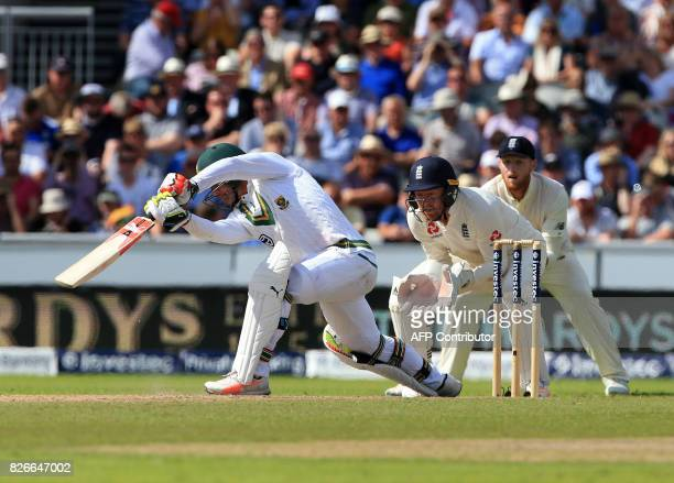 South Africa's Heino Kuhn is caught by England's Ben Stokes off the batting of England's Moeen Ali on the second day of the fourth Test match between...