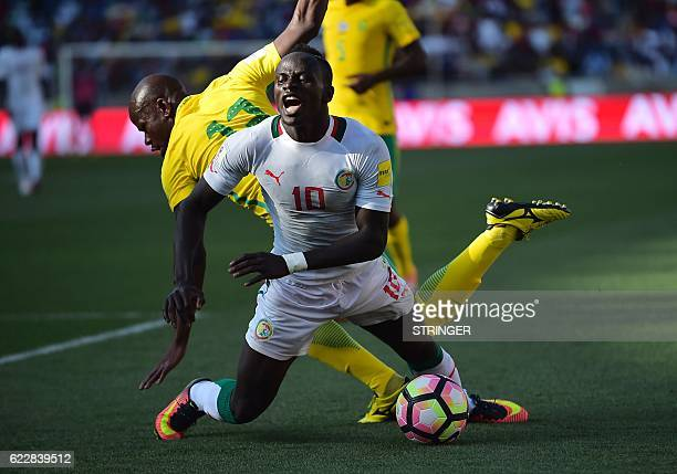 TOPSHOT South Africa's Hlompho Kekana tackles Senegal's Sadio Mane during the 2018 World Cup qualifying football match between South Africa and...