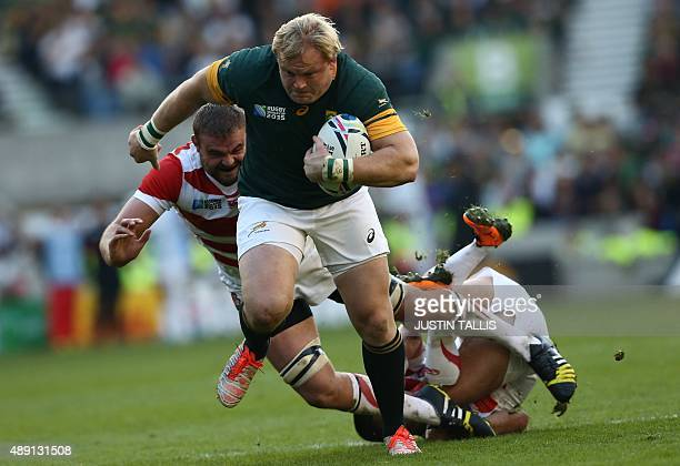 South Africa's hooker Adriaan Strauss runs through to score a try during a Pool B match of the 2015 Rugby World Cup between South Africa and Japan at...