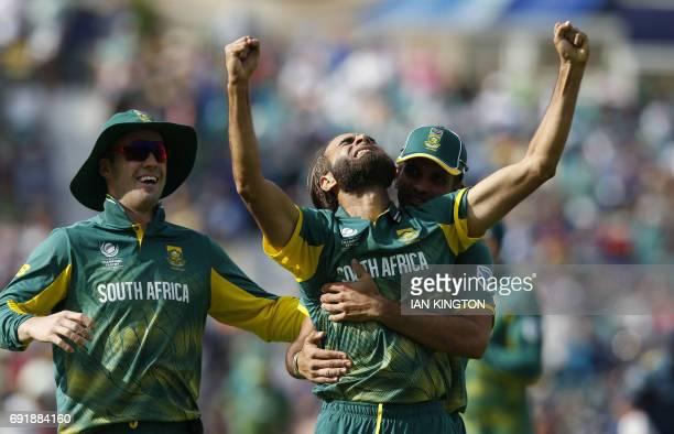 TOPSHOT South Africas Imran Tahir celebrates with teammates taking the wicket of Sri Lankas Asela Gunaratne for four runs during the ICC Champions...