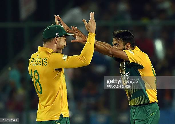 South Africa's Imran Tahircelebrates the wicket of Sri Lanka's Chamara Kapugedera with captain Faf du Plessis during the World T20 cricket tournament...