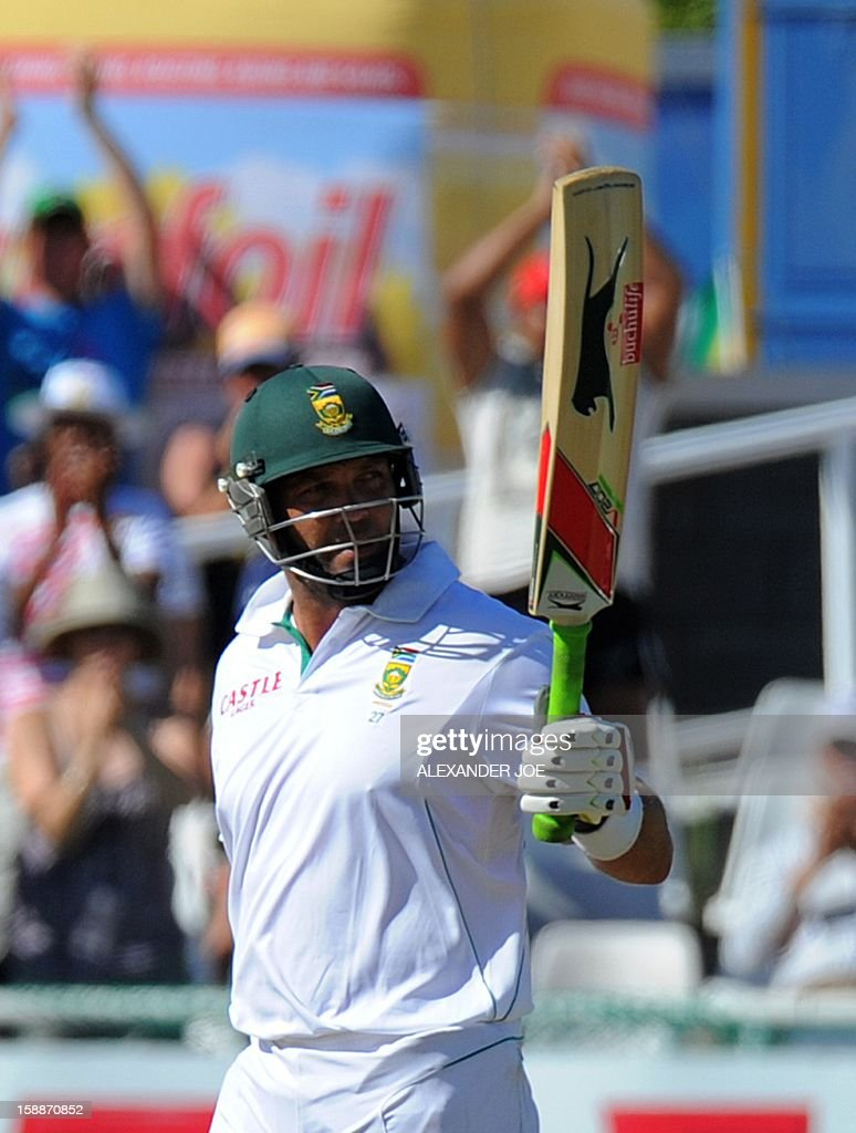 South Africa's Jacques Kallis, raise his bat after scoring a half century (50 runs) during day one of the first Test match between South Africa and New Zealand, in Cape Town at Newlands on January 2, 2013. AFP PHOTO / ALEXANDER JOE