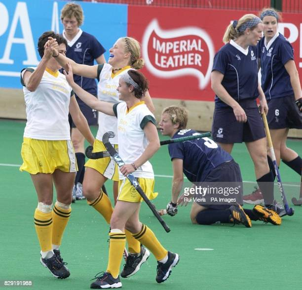South Africa's Johke Koornhof celebrates after scoring with Pietie Coetzee and Kerry Bee leaving dejected Scotland's players during the Women's...