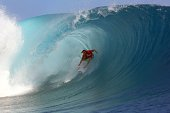 South Africa's Jordy Smith rides a wave on August 18 2014 during the 14th edition of the Billabong Pro Tahiti surf event part of the ASP world tour...