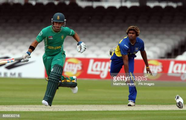 South Africa's JP Duminy attempts to make his ground as Sri Lanka's Lasith Malinga throws the ball during the Twenty20 World Cup warm up match at...