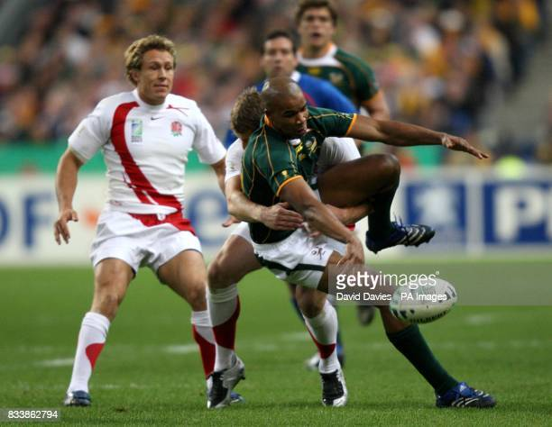 South africa's JP Pieterson is tackled by England's Mark Cueto