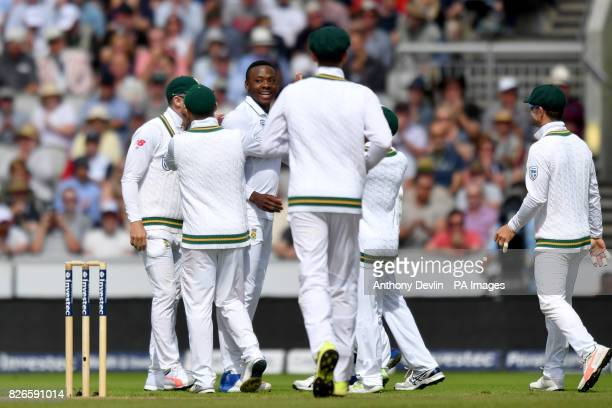 South Africa's Kagiso Rabada celebrates as England's Moeen Ali is caught behind by South Africa's Quinton de Kock during day two of the Fourth...
