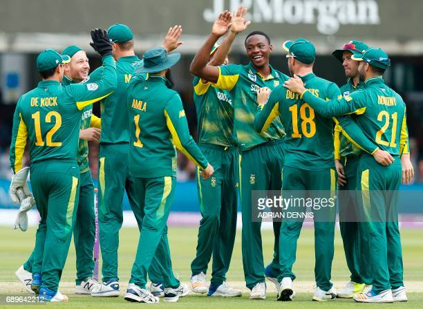 South Africa's Kagiso Rabada celebrates with team mates after taking the wicket of England's Adil Rashid for zero runs during the third OneDay...