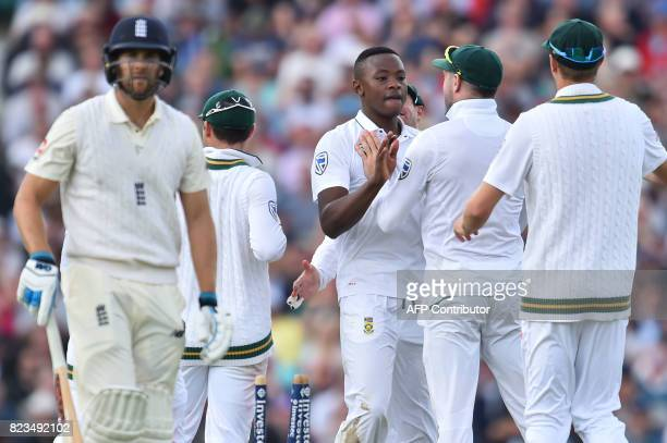 South Africa's Kagiso Rabada celebrates with theammates bowling out England's Dawid Malan for one on the first day of the third Test match between...