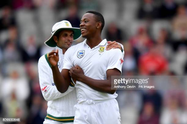 South Africa's Kagiso Rabada is congratulated by Keshav Maharaj after England's Keaton Jennings is caught behind for 18 runs during day three of the...