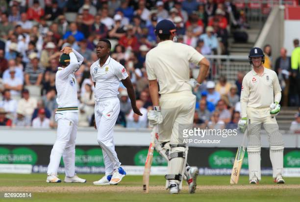 South Africa's Kagiso Rabada reacts to a dropped catch by South Africa's Quinton de Kock off the batting of England's Keaton Jennings on the third...