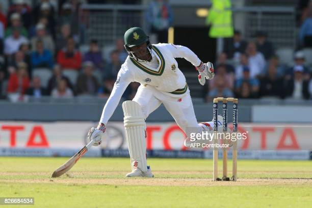 South Africa's Kagiso Rabada runs on the second day of the fourth Test match between England and South Africa at Old Trafford cricket ground in...