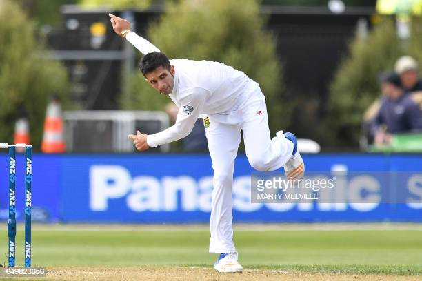 South Africa's Keshav Maharaj bowls during day two of the 1st International cricket Test match between New Zealand and South Africa at the University...