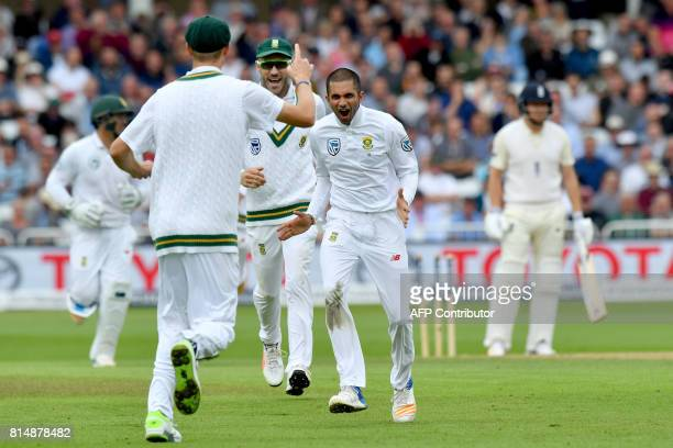 South Africa's Keshav Maharaj celebrates bowling England's Jonny Bairstow for 45 runs during play on the second day of the second Test match between...