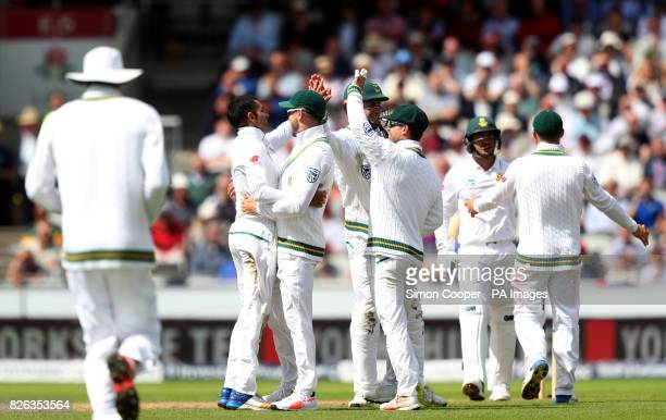 South Africa's Keshav Maharaj celebrates dismissing England's Alastair Cook with teammates during the Fourth Investec Test at Emirates Old Trafford...