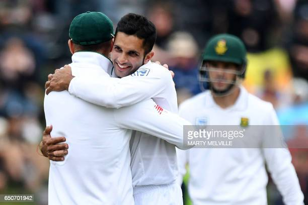 South Africa's Keshav Maharaj celebrates New Zealand's BJ Watling being bowled with captain Faf du Plessis during day three of the first...