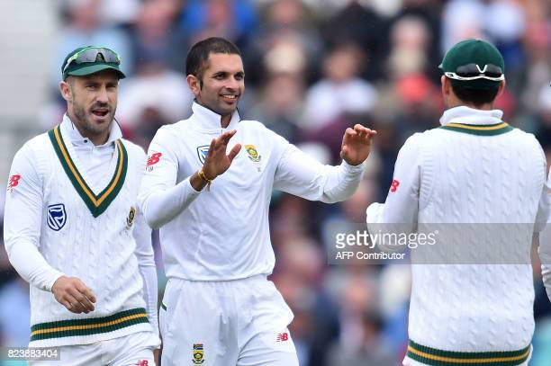 South Africa's Keshav Maharaj celebrates with teammates the wicket of England's Toby RolandJones for 25 on the second day of the third Test match...