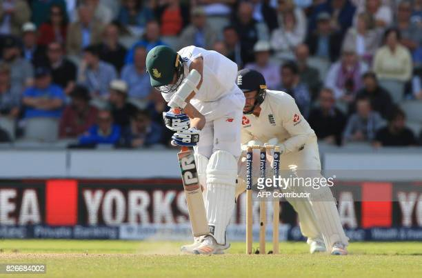 South Africa's Keshav Maharaj is bowled by England's Moeen Ali on the second day of the fourth Test match between England and South Africa at Old...