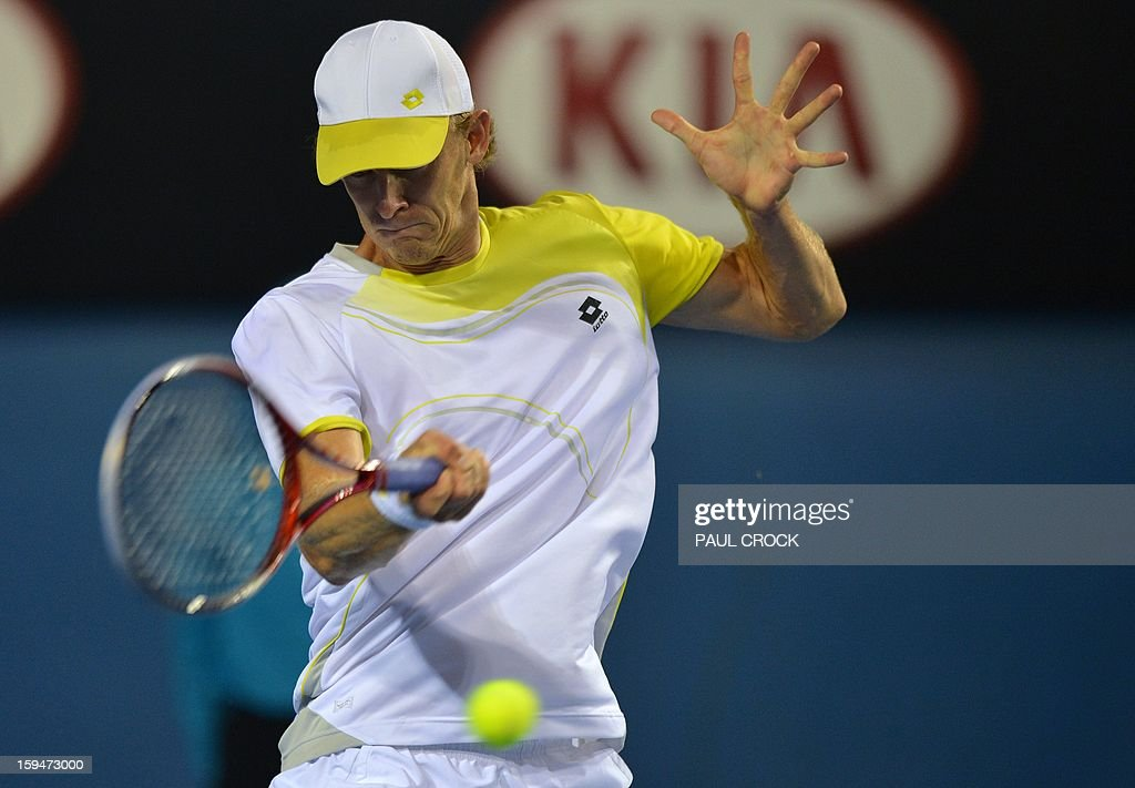 South Africa's Kevin Anderson hits a return against Italy's Paolo Lorenzi during their men's singles first round match on day one of the Australian Open tennis tournament in Melbourne on January 14, 2013.
