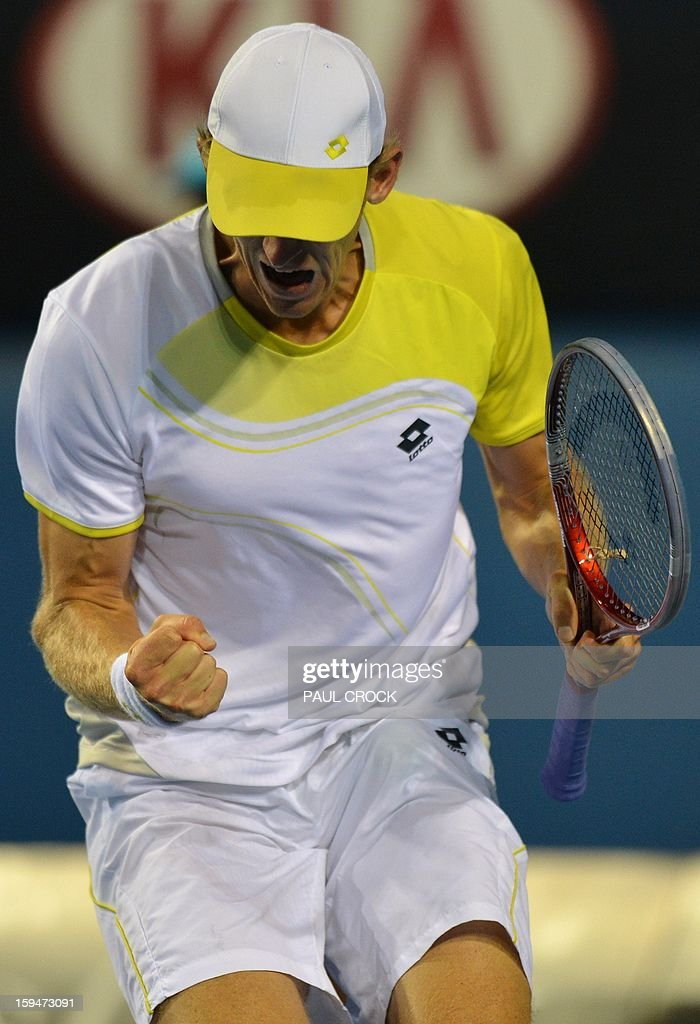 South Africa's Kevin Anderson reacts after a point against Italy's Paolo Lorenzi during their men's singles first round match on day one of the Australian Open tennis tournament in Melbourne on January 14, 2013.