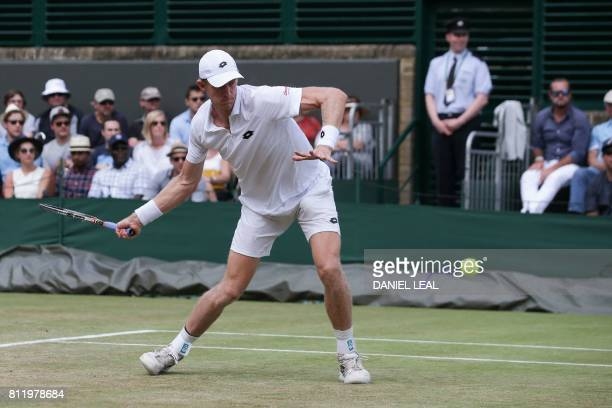 South Africa's Kevin Anderson returns against US player Sam Querrey during their men's singles fourth round match on the seventh day of the 2017...