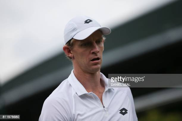 South Africa's Kevin Anderson returns to his seat after a game against US player Sam Querrey during their men's singles fourth round match on the...