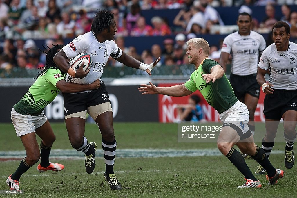 South Africa's <a gi-track='captionPersonalityLinkClicked' href=/galleries/search?phrase=Kyle+Brown+-+Rugby+Player&family=editorial&specificpeople=5870383 ng-click='$event.stopPropagation()'>Kyle Brown</a> (R) tries to tackle Fiji's Pio Tuwai (L) during a semi-final match between Fiji and South Africa on the third and final day of the rugby sevens tournament in Hong Kong on March 29, 2015. Fiji won 21-15. AFP PHOTO / Philippe Lopez