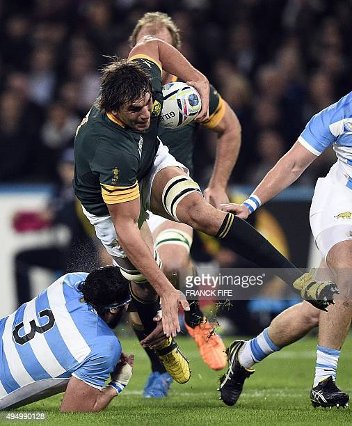 South Africa's lock Eben Etzebeth is tackled by Argentina's prop Ramiro Herrera during the bronze medal match of the 2015 Rugby World Cup between...