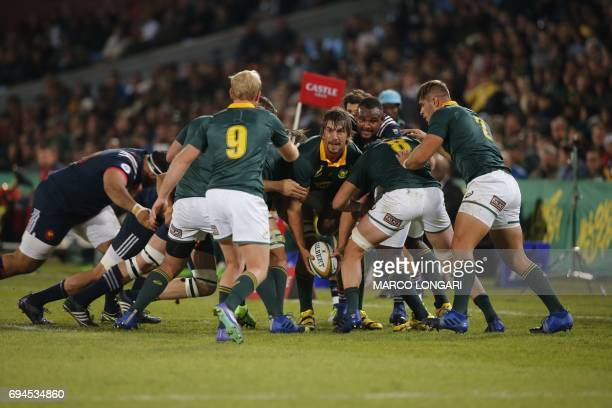 South Africa's lock Eben Etzebeth prepares to pass the ball from a maul during the first rugby union Test match between South Africa and France at...