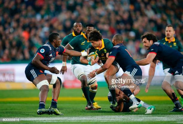 South Africa's lock Franco Mostert is tackled during the third rugby union Test match between South Africa and France at The Emirates Ellis Park...