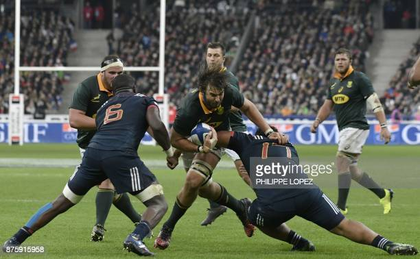South Africa's lock Lood de Jager is tackled during the friendly rugby union international Test match between France and South Africa's Springboks at...