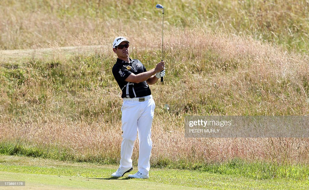 South Africa's Louis Oosthuizen plays onto the second green during the first round of the 2013 British Open Golf Championship at Muirfield golf course at Gullane in Scotland on July 18, 2013 .