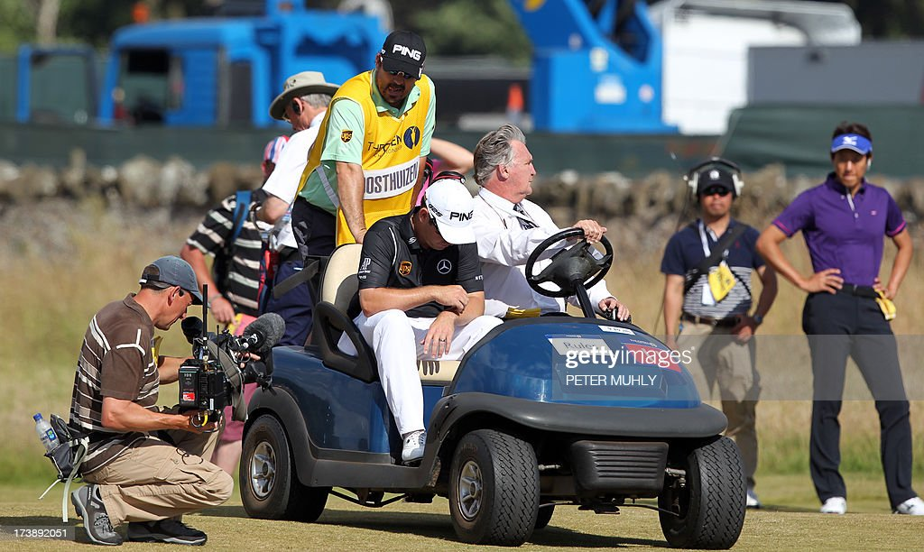 South Africa's Louis Oosthuizen sits in a buggy after he withdrew from competition during the first round of the 2013 British Open Golf Championship at Muirfield golf course at Gullane in Scotland on July 18, 2013. Oosthuizen withdrew from the British Open after nine holes of the first round at Muirfield with what appeared to be a leg injury. AFP PHOTO/PETER MUHLY