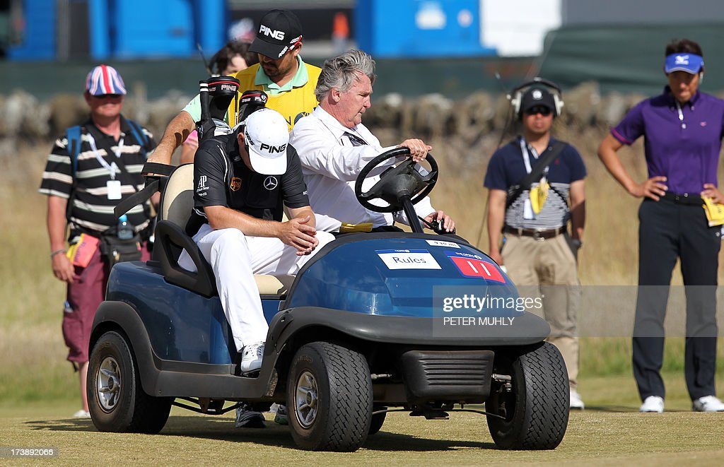 South Africa's Louis Oosthuizen sits in a buggy after he withdrew from competition during the first round of the 2013 British Open Golf Championship at Muirfield golf course at Gullane in Scotland on July 18, 2013. Oosthuizen withdrew from the British Open after nine holes of the first round at Muirfield with what appeared to be a leg injury.