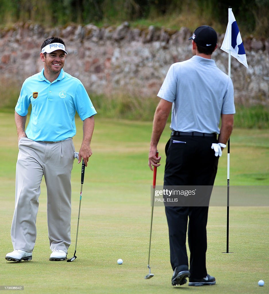 South Africa's Louis Oosthuizen (L) walks across the second green at Muirfield golf course in Gullane, Scotland on July 16, 2013 ahead of The 2013 British Open Golf Championship. AFP PHOTO/Paul ELLIS