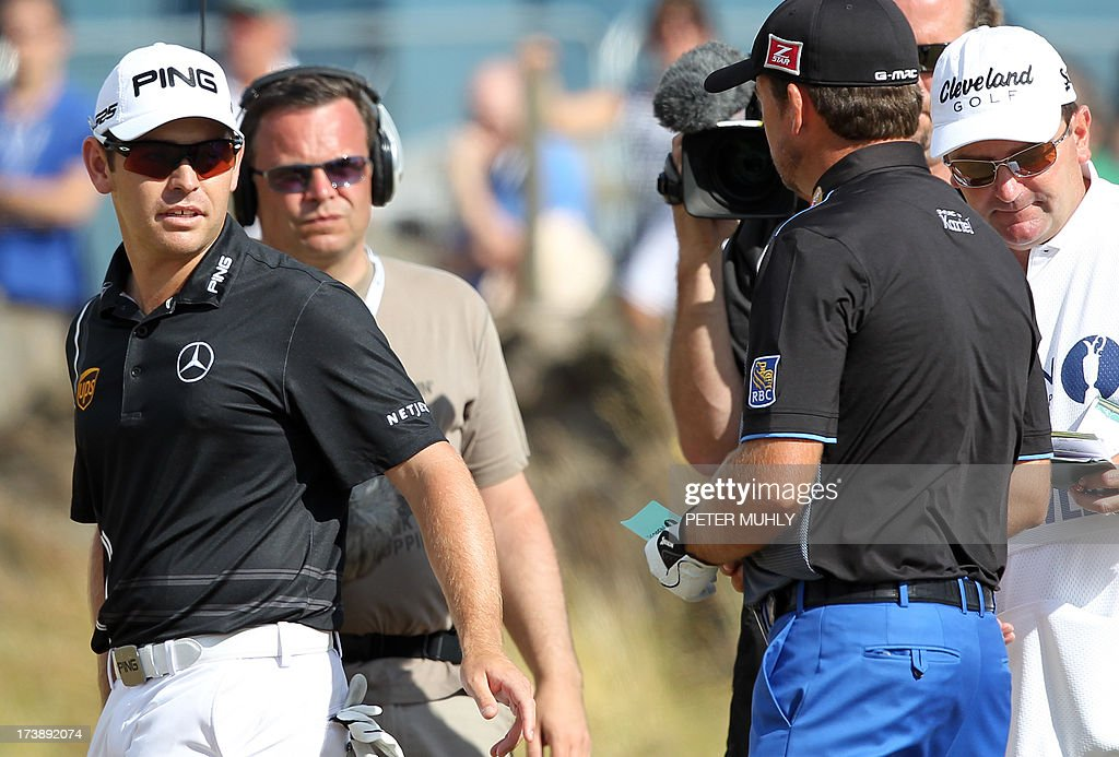 South Africa's Louis Oosthuizen (L) walks off after he withdrew from competition during the first round of the 2013 British Open Golf Championship at Muirfield golf course at Gullane in Scotland on July 18, 2013. Oosthuizen withdrew from the British Open after nine holes of the first round at Muirfield with what appeared to be a leg injury. AFP PHOTO/PETER MUHLY
