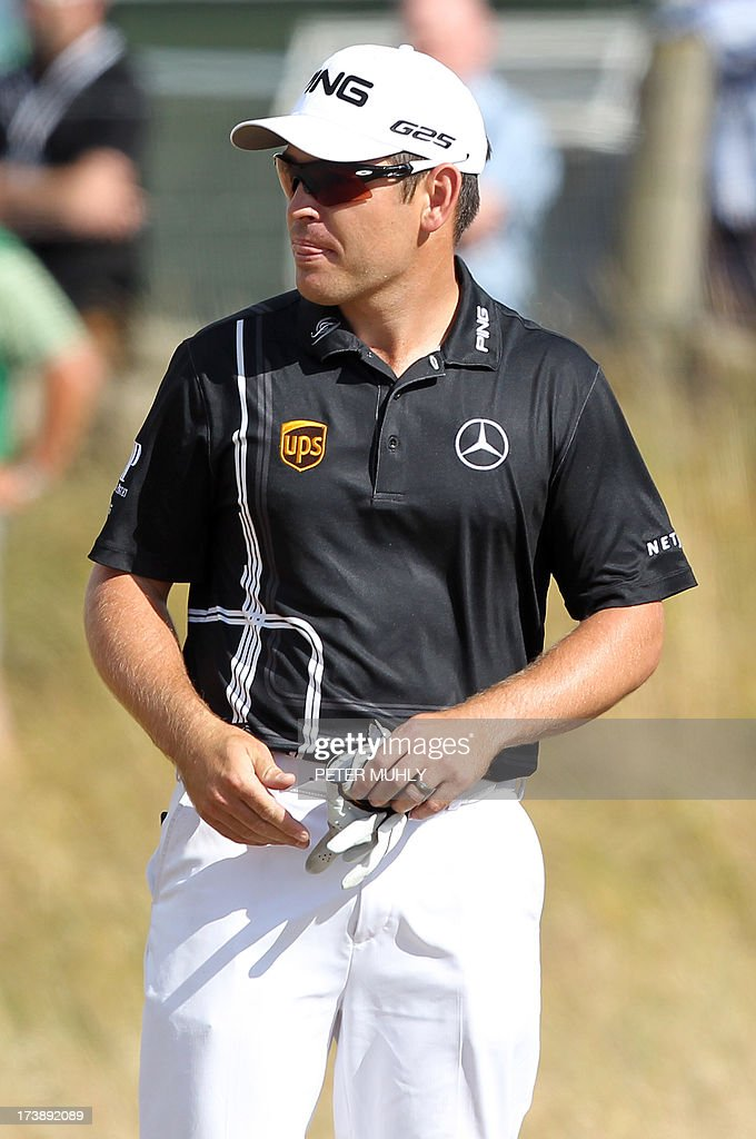 South Africa's Louis Oosthuizen walks off after he withdrew from competition during the first round of the 2013 British Open Golf Championship at Muirfield golf course at Gullane in Scotland on July 18, 2013. Oosthuizen withdrew from the British Open after nine holes of the first round at Muirfield with what appeared to be a leg injury. AFP PHOTO/PETER MUHLY